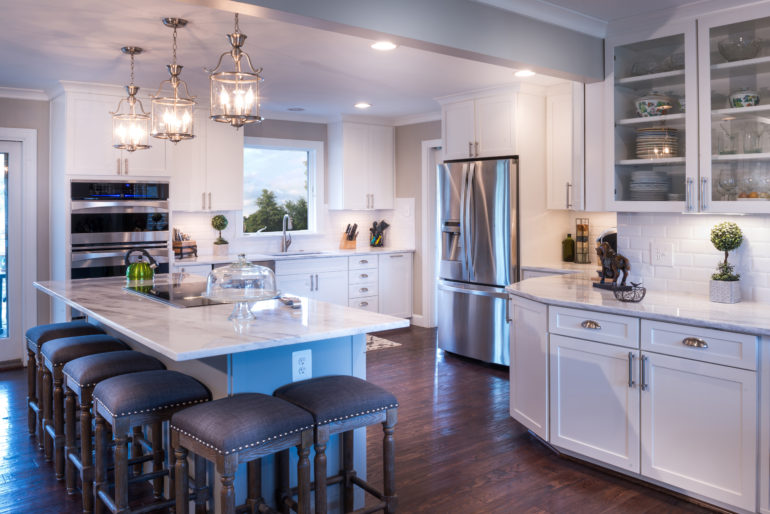 Well-designed white kitchen with white countertop